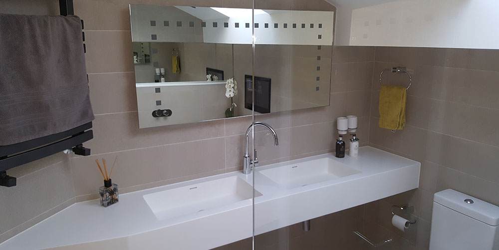 Bathroom with twin sinks and electric mirror